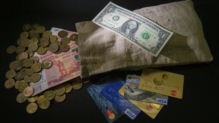 Денежные купюры и монеты России и США